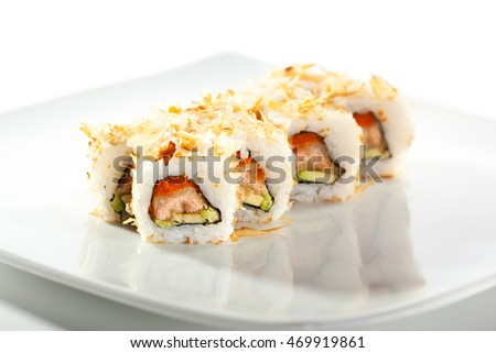 Salmon Skin Maki Sushi - Roll with Salmon Skin, Cucumber and Avocado inside. Grilled Sliced Tuna outside