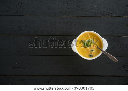 salmon soup with vegetables and thyme in white bowl. horizontal top view - stock photo