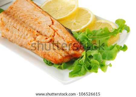 salmon steak and butter with green salad