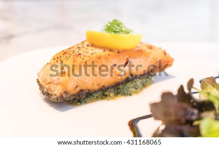 Salmon steak grilled with lemon - stock photo