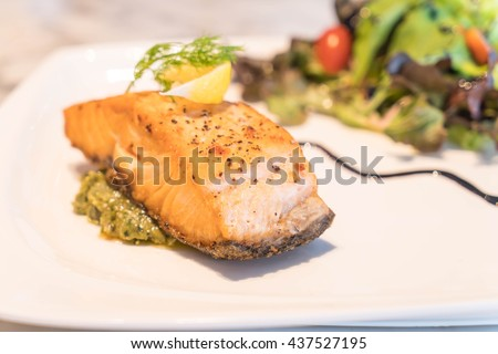 Salmon steak grilled with lemon