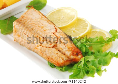 salmon steak on white plate with butter