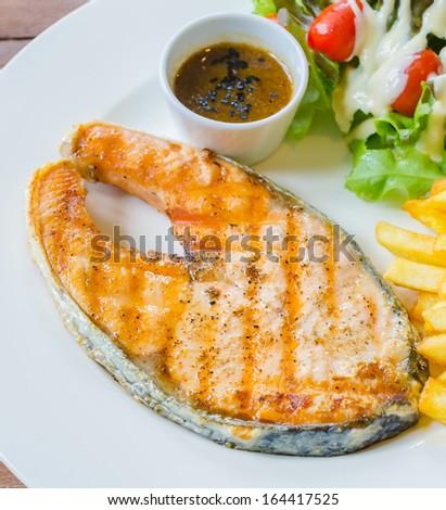 Salmon Steak on wood table - stock photo