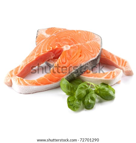Salmon steak red fish decorated with basil - stock photo