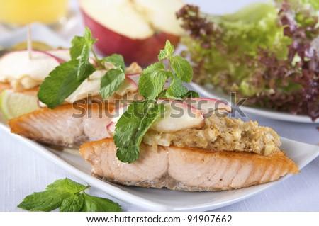 Salmon steak with apples - stock photo