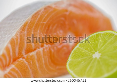 salmon steak with half of lime - stock photo