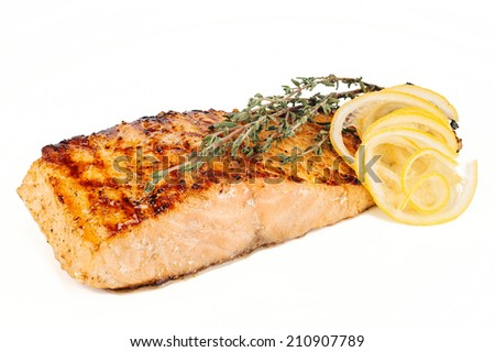 Salmon steak with lemon and rosemary on white background - stock photo