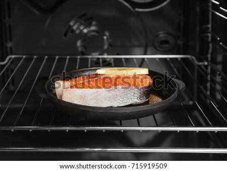 Salmon steak with lemon in oven