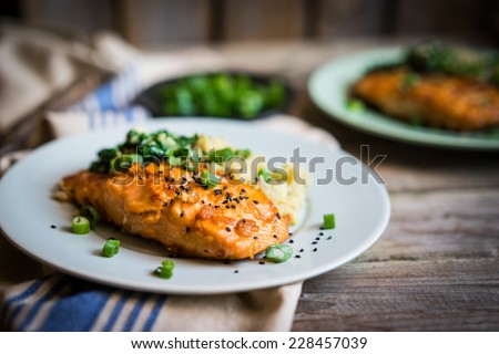Salmon steak with mashed potatoes and greens - stock photo