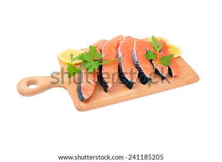 Salmon steak with parsley and lemon, isolated on white background - stock photo