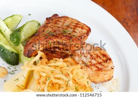 salmon steak with potatoes - stock photo