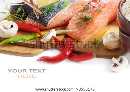 salmon steak with rice, vegetables and soy sauce - stock photo