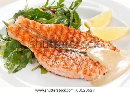 salmon steak with salad - stock photo