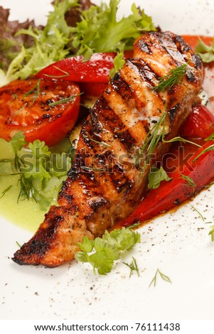 salmon steak with vegetables - stock photo