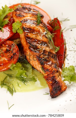 salmon steak with vegetables - stock photo