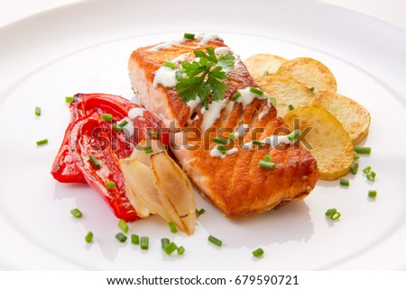 Salmon Steak with Vegetables and fried potatoes.