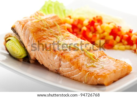 Salmon Steak with Vegetables and Salad Leaf - stock photo