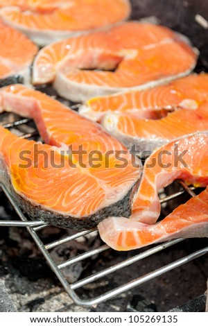 Salmon steaks grilling on the barbecue