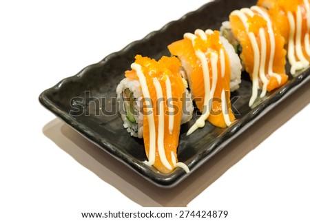Salmon sushi roll isolated on white background - stock photo