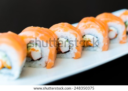 Salmon sushi roll japanese food - selective focus point