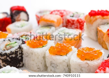 Salmon sushi rolls - asian food restaurant delivery, closeup of platter set on white background