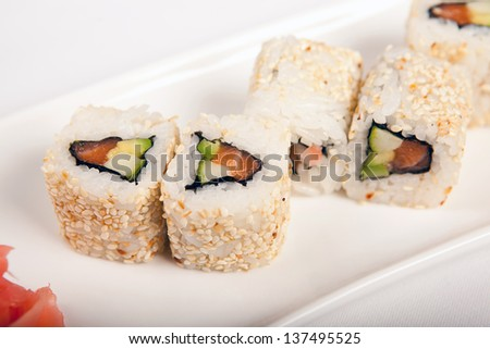 salmon sushi with cucumber and sesame - stock photo