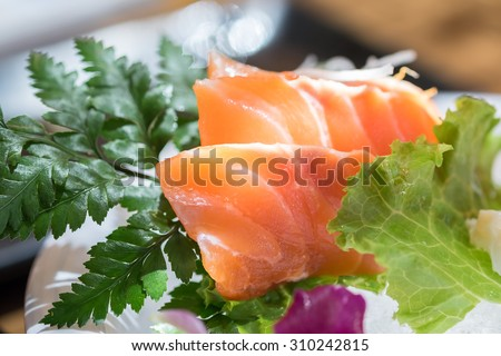 Salmon Sushi with the line of sunlight from the window (Selective Focus)