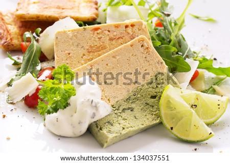 salmon terrine with rocket salad - stock photo