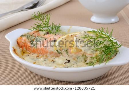 Salmon under gentle creamy lemon sauce with spices - stock photo