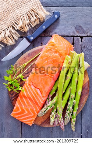salmon with asparagus - stock photo