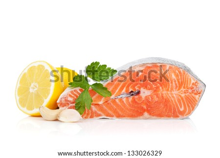Salmon with herbs and lemon. Isolated on white background - stock photo