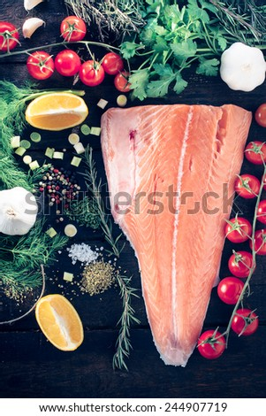 Salmon with large group of ingredients from above - stock photo