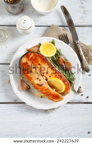 Salmon with lemon on a plate, food - stock photo