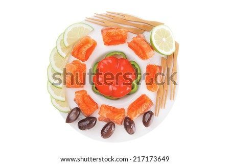 salmon with olives on white round plate - stock photo