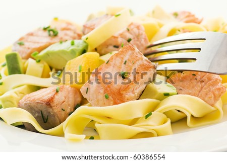 Salmon with Tagliatelle and Fruits - stock photo