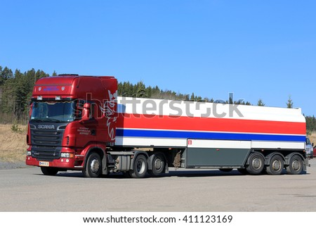 SALO, FINLAND - APRIL 16, 2016: Red Scania R580 Semi tank truck stops at the asphalt yard of a truck stop in South of Finland on a sunny day with blue sky. - stock photo
