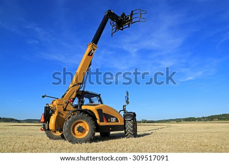 SALO, FINLAND - AUGUST 21, 2015: Cat TH407C Telescopic handler on display at the day of setting up Puontin Peltopaivat Agricultural Harvesting and Cultivating Show. - stock photo