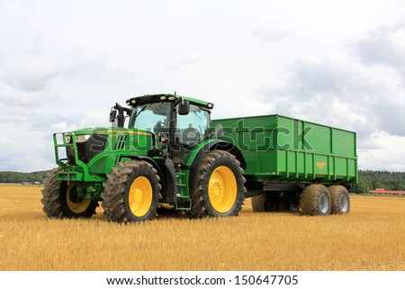 SALO, FINLAND - AUGUST 10: John Deere 6170R tractor and Palmse 1900 trailer on display at the annual Puontin Peltopaivat Agricultural Harvesting and Ploughing Show on August 10, 2013 in Salo, Finland. - stock photo