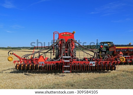 SALO, FINLAND - AUGUST 21, 2015: Vaderstad Spirit 600C Seed Drill and John Deere tractor on field at the set up of Puontin Peltopaivat Agricultural Harvesting and Cultivating Show. - stock photo