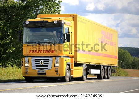 SALO, FINLAND - AUGUST 30, 2015: Yellow Renaut Magnum semi truck on the road. Renault Magnum was manufactured in 1990-2013 and it received the International Truck of the Year award  in 1991. - stock photo