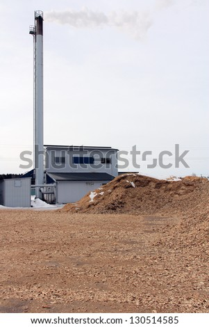SALO, FINLAND - CIRCA MARCH, 2013: Bio power plant with storage of wood chips in Salo, Finland circa March, 2013. Wood directly or indirectly accounts for fifth of the energy used in Finland.