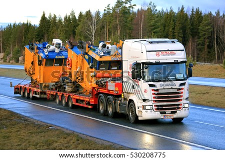 SALO, FINLAND - DECEMBER 5, 2016: Scania R580 of Ahola Special Transport hauls Adam and David self-propelled split-hopper barges which are used for transportation and dumping of dredged material.