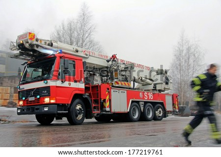 SALO, FINLAND - FEBRUARY 16, 2014: Fire Brigade arrives at the Cement Plant fire scene in Salo, Finland. The plant was completely destroyed in the fire.  - stock photo