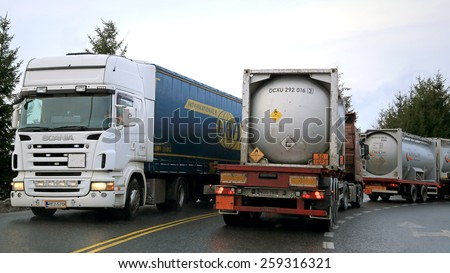 SALO, FINLAND - JANUARY 15, 2015: Busy trailer truck traffic through Salo, Finland. The decline in diesel fuel prices does not result in transport economy according to the the Finnish SKAL barometer. - stock photo