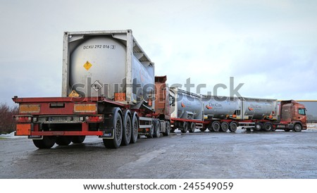 SALO, FINLAND - JANUARY 17, 2015: Two tank trucks haul flammable goods. The ADR label 50-1495 stands for sodium chlorate.  - stock photo