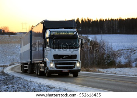SALO, FINLAND - JANUARY 5, 2017: White Volvo FH transport truck of Kulmala Oy hauls goods along highway at sunset on a cold winter evening in South of Finland.