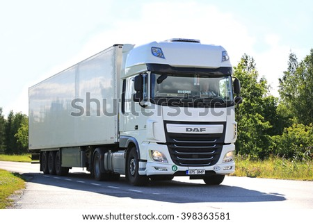 SALO, FINLAND - JULY 24, 2015: New white DAF XF semi truck on summer road in Salo. PACCAR reports strong revenues and net income for the Q3 of 2015. - stock photo