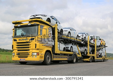 SALO, FINLAND - JULY 26, 2015: Scania R500 car carrier hauls new cars along road. A scrapping scheme for old vehicles will be carried out in Finland between 1 July and 31 December 2015. - stock photo