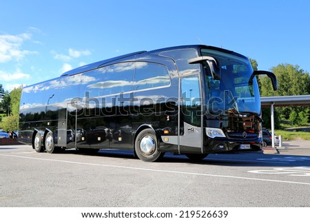 SALO, FINLAND - JUNE 14, 2014: Black Mercedes-Benz Travego bus stops at bus parking. At IIA, Daimler presents the Safety Coach version of Travego bus with ABA 3. - stock photo