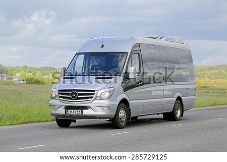 SALO, FINLAND - JUNE 7, 2015: Mercedes-Benz Sprinter minibus transports passengers. The MB Sprinter has a seating capacity from 13 to 19 passengers. - stock photo